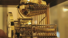 Close up of the gearsystem of an unique clock with an unique bell sound system Stock Footage