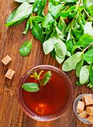 mint tea on wooden table, - stock photo