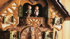 Detail of a Cuckoo-clock with dancing puppets, close up Stock Footage