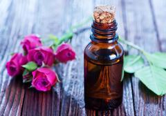 rose oil in bottle - stock photo