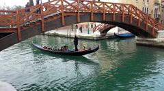 Romantic couple enjoy honeymoon on beautiful gondola ride Stock Footage
