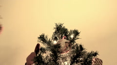 Decorating Christmas tree with a star Stock Footage