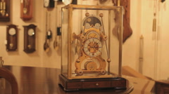 Antique table clock in a clock store, ticking the time - stock footage