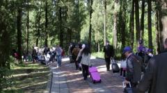 Pilgrims, tourists walk to the monastery Stock Footage