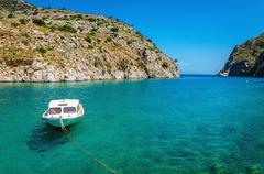 Small white motorboat anchored in sea bay, Greece Stock Photos