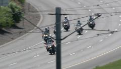 Several Police Officers Riding Motocycles Stock Footage