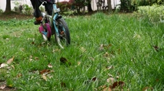 Child ride bicycle on grassland Stock Footage