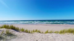 Walking in the dunes along the beach Stock Footage