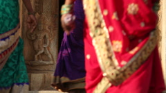 View of women in beautiful colourful dresses entering in to the temple. - stock footage