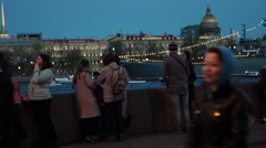 Neva river embankment is at white nights with people at walk - stock footage