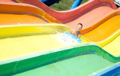 child  having fun in aqua park - stock photo