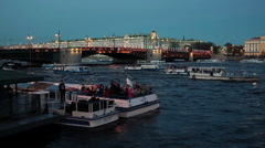 White night pleasure boats are on Neva river through the Palace bridge, Russia Stock Footage