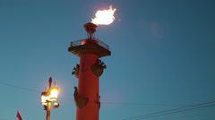 Burning torch of fire on the Rostral Column in the St. Petersburg city, Russia.  Stock Footage