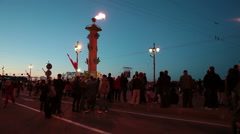 Russian people stand under fire of Rostral Column and wait for firework - stock footage