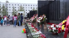 Memorial victory day people put flowers Stock Footage