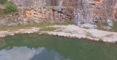Aerial image of a young couple running in a disused quarry located in Campo Magr Stock Footage