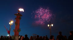 Colored firework explosions in sky and burning fire on Rostral column, Russia - stock footage