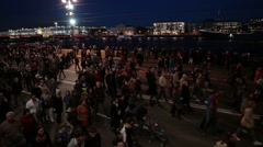 The flow of people is on city embankment after firework show, St. Petersburg - stock footage
