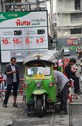 "BANGKOK THAILAND - MAR 29: Traditional street taxi ""tuk-tuk"" awaits passenger - stock photo"