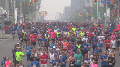 Massive crowd of marathon runners in the streets of the city of Toronto Stock Footage