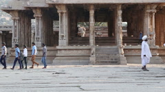 Indian school boys in blue shirts walking in front of the building in Hampi. Stock Footage