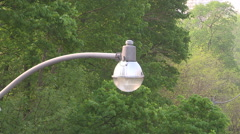 Stock Video Footage of Old fashioned incandescent street lamp in city of Toronto