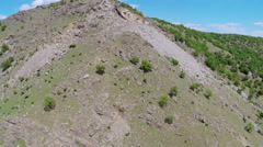 Aerial over a rock covered mountain ridge Stock Footage