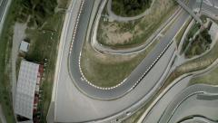 Aerial 4k top shot of a curve at Montmelo F1 Circuit. Spain Stock Footage