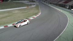 Aerial front view of a car at Montmelo F1 Circuit. Spain Stock Footage