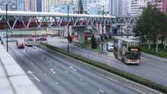 Street crossing, pedestrian overpass, urban suburb area of Hong Kong Stock Footage