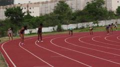 Sportswomen run on track. Running passing baton. Athletes. Runners.  Stock Footage