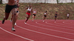 Sportswomen run on track. Runners. Athletes. Race, Games Stock Footage