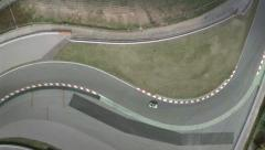 Aerial top shot of a curve at Montmelo F1 Circuit. Spain Stock Footage
