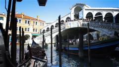 Rialto Bridge with gondolas in Venice Italy Stock Footage