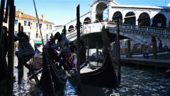 Asian tourists in gondola near Rialto Bridge in Venice Italy Stock Footage