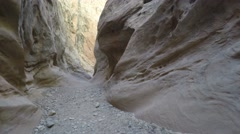 Tourists hike through the desert slot canyon in utah Stock Footage