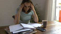 Woman worried about bills stressed sad paperwork 4k debts payments finances Stock Footage
