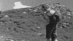 Switzerland 1953: woman walking in a mountain trail Stock Footage