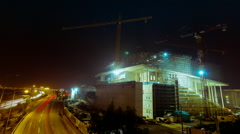 Night urban Construction site with cranes wide view highway timelapse Stock Footage