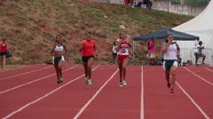 Sportswomen run on track. Race. Runners. Athletes. Games. Stock Footage