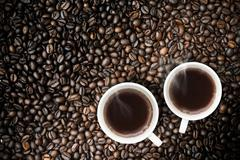 Fresh brewed Coffee With Coffeebeans - stock photo