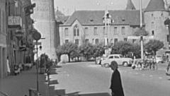 Yverdon-les-Bains 1953: people walking in front fo the castle Stock Footage