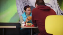 Woman and Man Eating Hamburgers And French Fries Arkistovideo