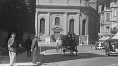 Yverdon-les-Bains 1953: traffic in front of the main church Stock Footage