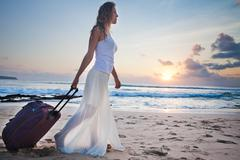 Woman adventure with own luggage Stock Photos