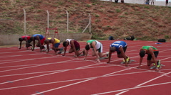 Sportsmen run on track. Race. Runners. Athletes. Starting Line. Stock Footage