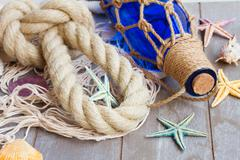 Compass on fishing net Stock Photos