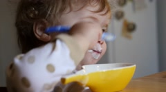Child eating yoghourt Stock Footage