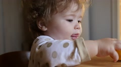Child eating orange - stock footage