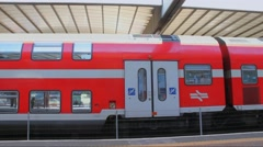 Red double-decker train waiting for departure from  railway station Stock Footage